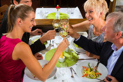 Family with adult kids in Restaurant Stock Images