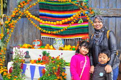 A family and African fruit stall. A family poses with an african fruit stall near Tokyo Disney Sea theme park Royalty Free Stock Image