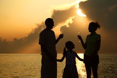 Family against glossing sea. Parents with glasses Royalty Free Stock Photo