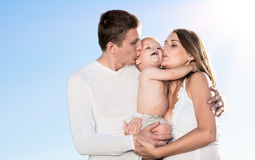 Family against the sky Royalty Free Stock Images
