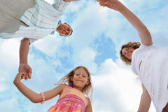 Family against sky, foreshortening from below Royalty Free Stock Image