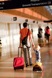 Family in the airport. Father and son with the luggage in the airport Royalty Free Stock Image