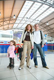 Family in an airport. Family with girl in an airport stock image