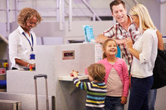 Family At Airport Check In Desk Leaving On Vacation Stock Photography