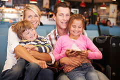 Family In Airport Departure Lounge Waiting To Go On Vacation Stock Image
