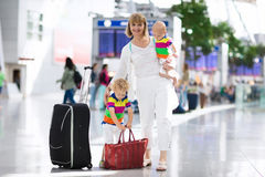 Family at airport before flight Royalty Free Stock Photo
