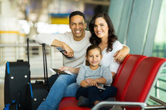 Family airport waiting. Cheerful family at airport waiting for flight Stock Images