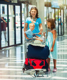 Family in the airport Stock Image