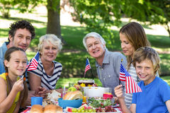 Family with American flag having a picnic Royalty Free Stock Images