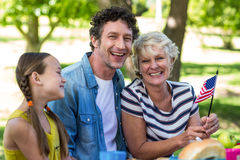 Family with American flag having a picnic Royalty Free Stock Photo