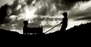 Family amusement with a carriage inthe evening Stock Photography