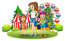 A family at the amusement park with a ferris wheel Royalty Free Stock Image