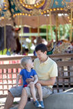 Family at amusement park. Happy laughing family of two at the amusement park Royalty Free Stock Photos