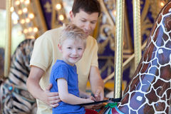 Family in amusement park Stock Photography