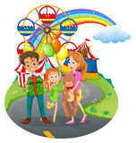 A family at the amusement park Stock Image