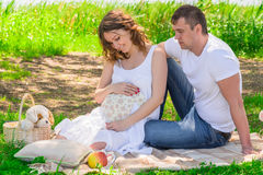 Family in anticipation of a child, rest near a lake Royalty Free Stock Photography