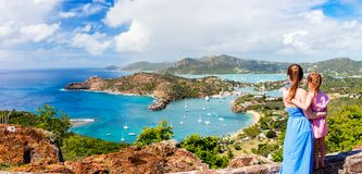 Family at Antigua Caribbean. Panorama of family mother and daughter enjoying aerial view of picturesque English Harbour at Antigua and Barbuda in Caribbean royalty free stock photography