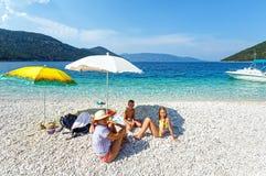 Family on Antisamos beach (Greece,  Kefalonia). Royalty Free Stock Photography
