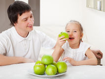 Family with apples Royalty Free Stock Image