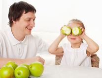 Family with apples Royalty Free Stock Images
