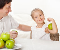 Family with apples Stock Photo