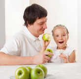 Family with apples Royalty Free Stock Photography