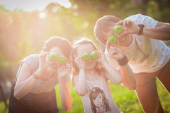 Family, apples, fun stock image