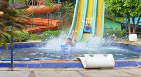 Family in aqua park. Happy family having fun in aqua park Royalty Free Stock Photography