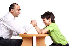 Family arm wrestling. Father and son arm wrestling isolated on white Royalty Free Stock Photo