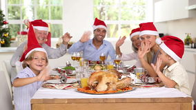 Family around the dinner table at christmas Royalty Free Stock Photography