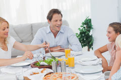 Family around the dinner table Stock Photography
