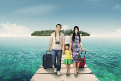 Family arriving at the resort island Royalty Free Stock Photography