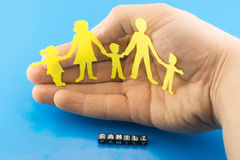 The family as a concept. On the background of hands Royalty Free Stock Photography