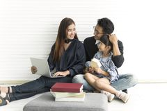 Family Asian mother and father with daughter happy together royalty free stock photos