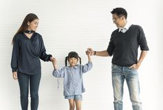 Family Asian mother and father with daughter happy together royalty free stock photography