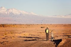Family in atacama desert. Back view of father and son hiking together in atacama desert, chile, driest place on earth, with gorgeous mountain views, active Stock Images