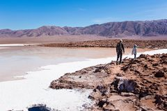 Family in atacama. Family of two, father and son, walking and hiking in lagunas escondidas, secret lagoons, in atacama desert, chile - driest place on earth Stock Image