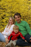 Family in autumn forest Royalty Free Stock Images