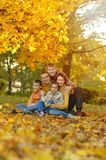Family in autumn forest Royalty Free Stock Image