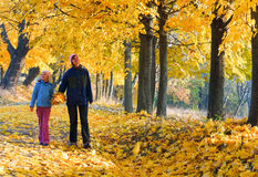 Family in autumn maple park Stock Photo