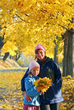 Family in autumn maple park Stock Photography