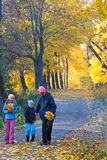 Family in autumn maple park Royalty Free Stock Photography