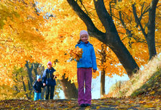 Family in autumn maple park Royalty Free Stock Photo