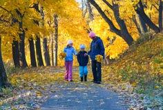 Family in autumn maple park Royalty Free Stock Photo