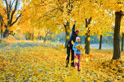 Family in autumn maple park Royalty Free Stock Image
