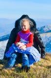 Family on autumn  mountain plateau. Stock Photos