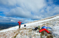 Family on autumn mountain plateau with first snow Royalty Free Stock Photo