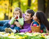 Family in autumn outdoors Royalty Free Stock Photography