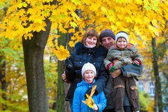 Family in autumn park Stock Images