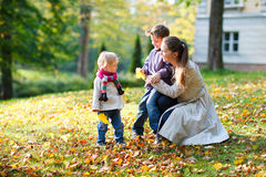 Family at autumn park Royalty Free Stock Photo